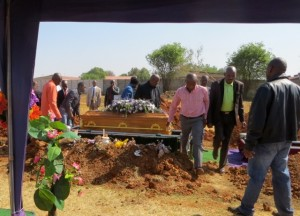 27sept14 - casket over grave