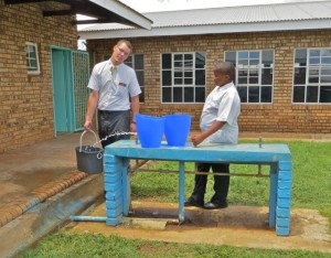 feb15 - Taylor, Magapi filling buckets